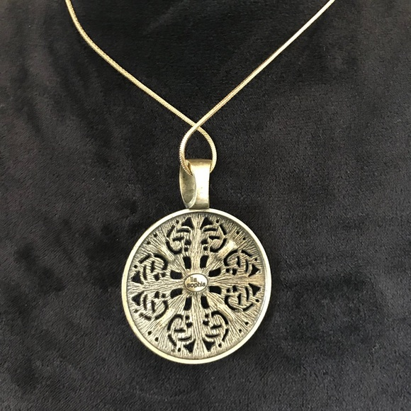 Necklace with bronze rosette pendant